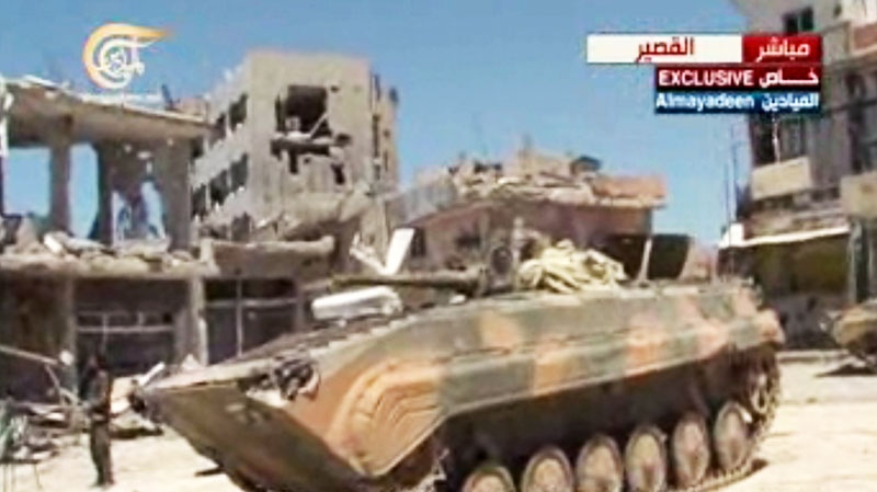 Syrian army tanks in Qusair, Syria, Wednesday, June 5, 2013. (AP Photo/Al-Mayadeen Television via AP video)