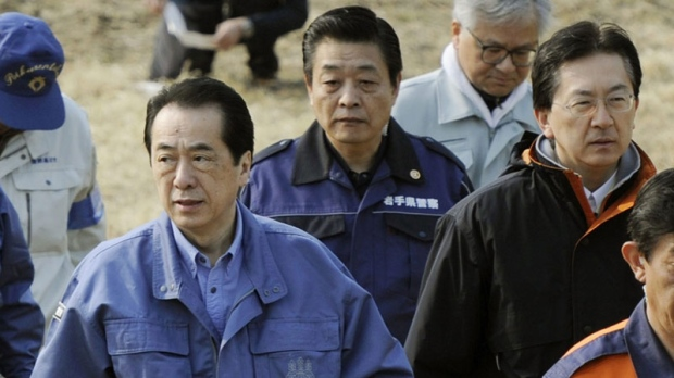 Japan's Prime Minister Naoto Kan arrives at Rikuzentakata, northern Japan to inspect the March 11 earthquake and tsunami devastated areas Saturday, April 2, 2011. (AP / Kyodo News)