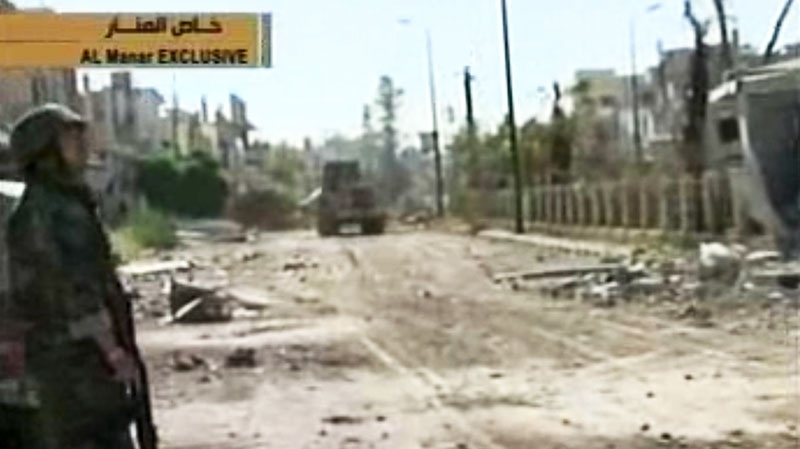 A Syrian army tank in Qusair, Syria, Wednesday, June 5, 2013. (Al-Manar Television via AP video)