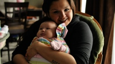 Christie Lee Charles speaks the Musqueam dialect with her daughter Kimora. (Kendall Walters/special to ctvbc.ca)
