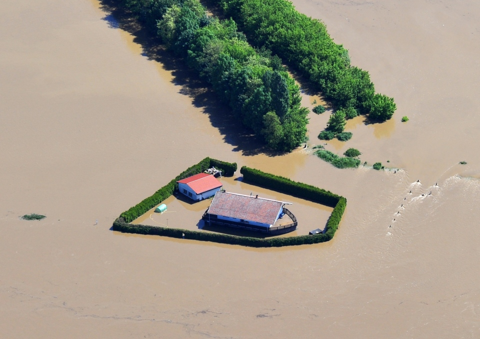 A farm is flooded by Elbe river near Strehla in eastern Germany on June 5, 2013. Heavy rainfalls cause flooding along rivers and lakes in Germany, Austria, Switzerland, the Czech Republic and Hungary. (dpa/Matthias Hiekel)