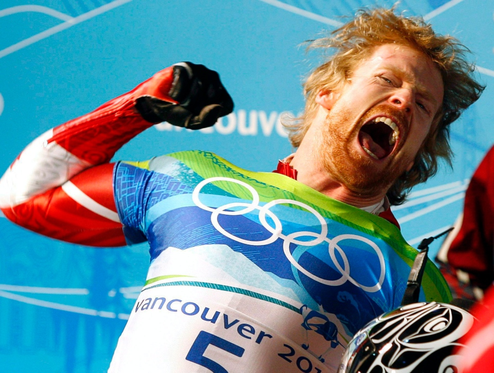 Canada's Jon Montgomery celebrates winning a gold medal in the men's skeleton competition at the Whistler Sliding Centre at the 2010 Vancouver Olympic Winter Games in Whistler, B.C., Friday, Feb. 19, 2010. Montgomery has been named the new host of 'Amazing Race Canada.' (Jeff McIntosh / THE CANADIAN PRESS)