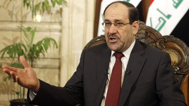 Iraqi Prime Minister Nouri al-Maliki speaks during an interview with the Associated Press at his office in the heavily protected Green Zone in Baghdad, Iraq, Saturday, April 2, 2011. (AP Photo/Karim Kadim)
