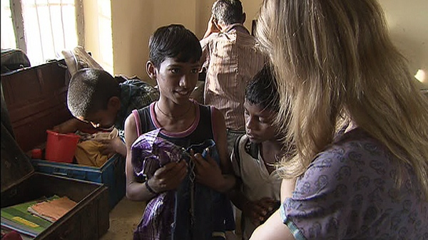CTV's Janis Mackey Frayer talks to a child about what is in his trunk. Each child at Child Haven has one trunk with all of his or her belongings. The practice comes from Mahatma Gandhi's belief that all worldly goods should be reduced to one metal trunk.