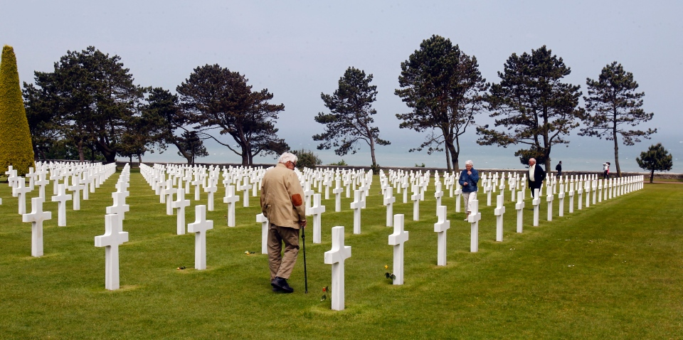 Visitors walk among graves at the Colleville American military cemetery, in Colleville sur Mer, western France, Thursday June 6, 2013, on the day of the commemoration of the 69th anniversary of the D-Day. (AP Photo/Remy de la Mauviniere)