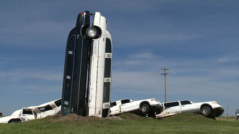 If you head north east of Edmonton, to the corner of Highway 831 and 50 Avenue in the town of Lamont, you'll see a strange sight: a number of limousines arranged in a very particular manner, some even upside down with their ends sticking high up in the sky.