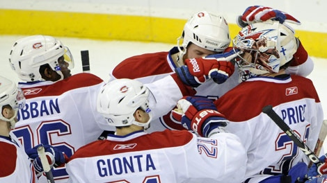 Montreal Canadiens' P. K. Subban, left, pokes goaltender Carey Price in the eye after the Canadiens defeated the New Jersey Devils 3-1 in an NHL hockey game on Saturday, April 2, 2011, in Newark, N.J. (AP Photo/Bill Kostroun)