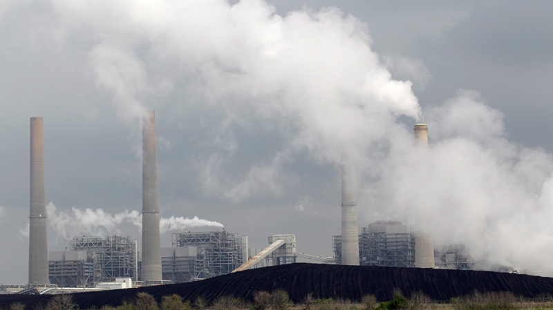Piles of coal are seen at NRG Energy's W.A. Parish Electric Generating Station in Thompsons, Texas, Wednesday, March 16, 2011. (AP Photo/David J. Phillip)
