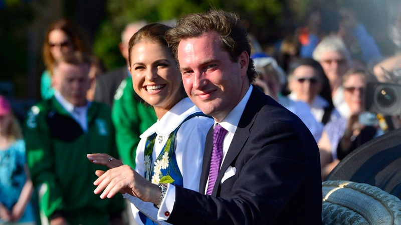 Swedish Princess Madeleine and her fiancé Chris O'Neill arrive in a horse drawn open carriage for the traditional National Day celebrations at Skansen in Stockholm, on Thursday, June 6, 2013. (Scanpix Sweden / Henrik Montgomery)