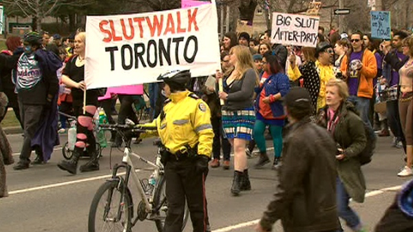 A large group of protesters walked the streets of Toronto towards Toronto Police headquarters on Sunday to rally against comments made by a police officer at York University's Osgoode Hall in January. April 3, 2011.