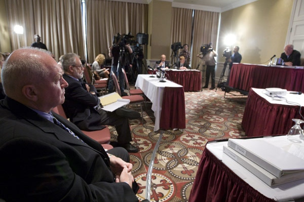 Walter Kosteckyj, left, lawyer for Zophia Cisowski, mother of Robert Dziekanski, looks on as commissioner Thomas Braidwood speaks during the first day of the Braidwood Inquiry in Vancouver, Monday, May 5, 2008. (Jonathan Hayward / THE CANADIAN PRESS)