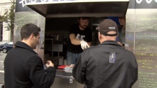 Customers are served at the Re-Up BBQ food cart in downtown Vancouver. (CTV)