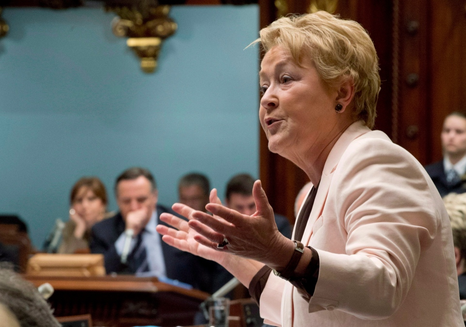 Quebec Premier Pauline Marois responds to second opposition questions as its leader Francois Legault, left, looks down, at the legislature in Quebec City, Thursday, June 6, 2013.  (Jacques Boissinot / THE CANADIAN PRESS)