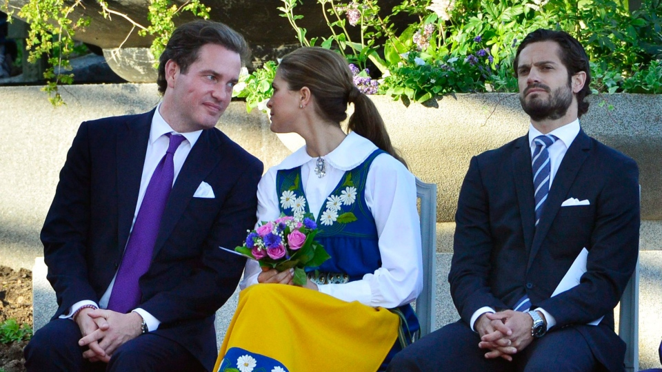 Swedish Princess Madeleine, center, her fiancée, New York banker Chris O'Neill, left, and her brother Prince Carl Philip seen during the traditional National Day celebrations at Skansen in Stockholm, Thursday, June 6, 2013.  (Scanpix Sweden / Henrik Montgomery)