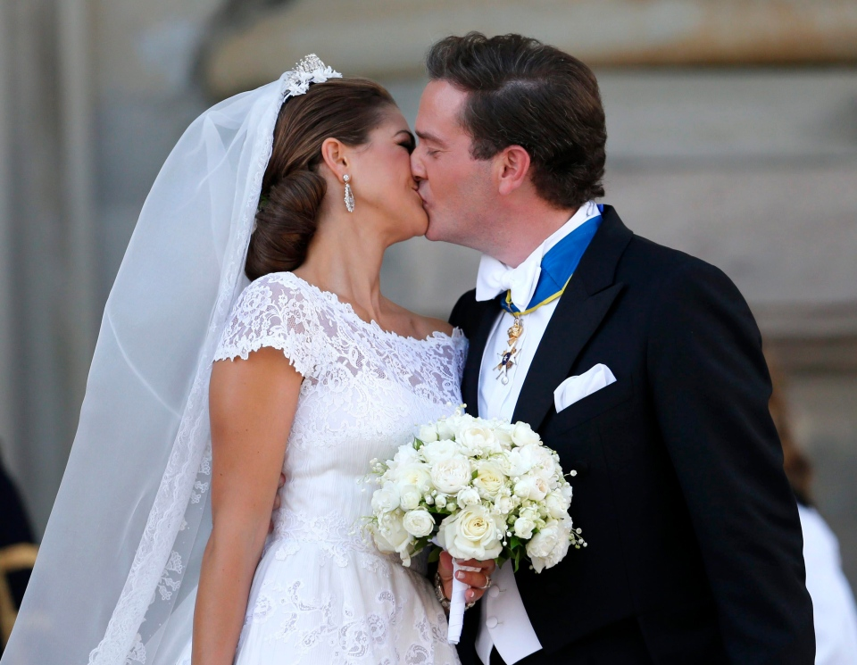 Sweden's Princess Madeleine and Christopher O'Neill kiss outside the Royal Chapel after their wedding ceremony in Stockholm, Saturday June 8, 2013. (AP / Bjorn Larsson Rosvall)