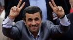 Iranian President Mahmoud Ahmadinejad greets Venezuelans upon his arrival to the National Assembly for President-elect Nicolas Maduro's inaugural ceremony in Caracas, Venezuela, April 19, 2013. (AP / Fernando Llano)