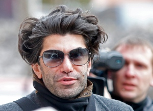 Bolshoi principal dancer Nikolai Tsiskaridze walks to a court to take part in the first hearing of a civil lawsuit he is bringing against the Bolshoi theatre's general director as part of an effort to unseat him, in Moscow, Russia on Friday, April 12, 2013. (AP / Misha Japaridze)