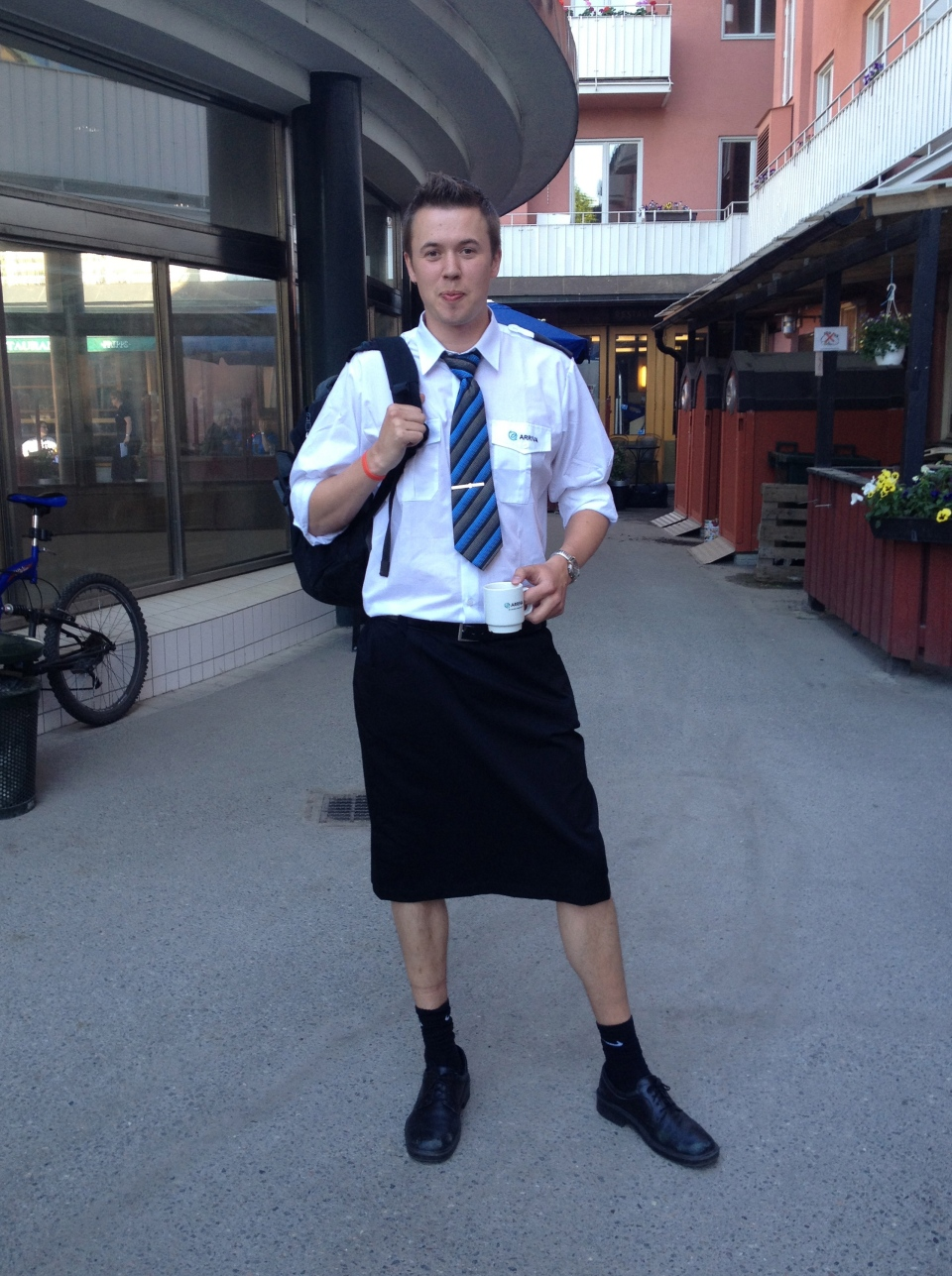 Swedish train driver Martin Akersten poses wearing a skirt with his cell phone in Stockholm on May 31, 2013. (AP / Kim Jensen)