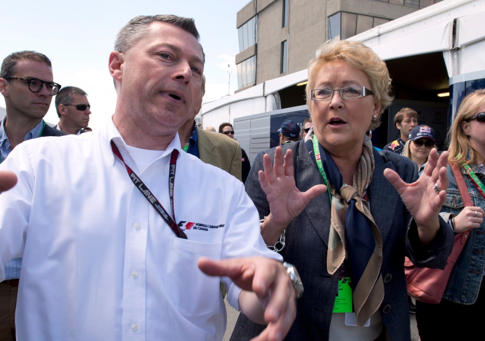 Quebec Premier Pauline Marois, right, chats with Francois Dumontier, president of Octane Management and promoter of the Montreal Grand-Prix before the sart of the race Sunday, June 9, 2013 at the Canadian Grand Prix in Montreal. THE CANADIAN PRESS/Jacques Boissinot