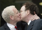 Michael Stark, left, and Michael Leshner kiss after their marriage in Superior Court in Toronto on Tuesday, June 10, 2003. (Frank Gunn /The Canadian Press)