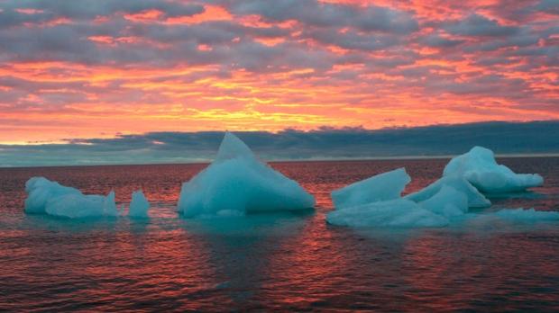 Ice chunks float in the Arctic Ocean as the sun sets near Barrow, Alaska, Sept. 13, 2006. (AP / Arctic Sounder, Beth Ipsen)