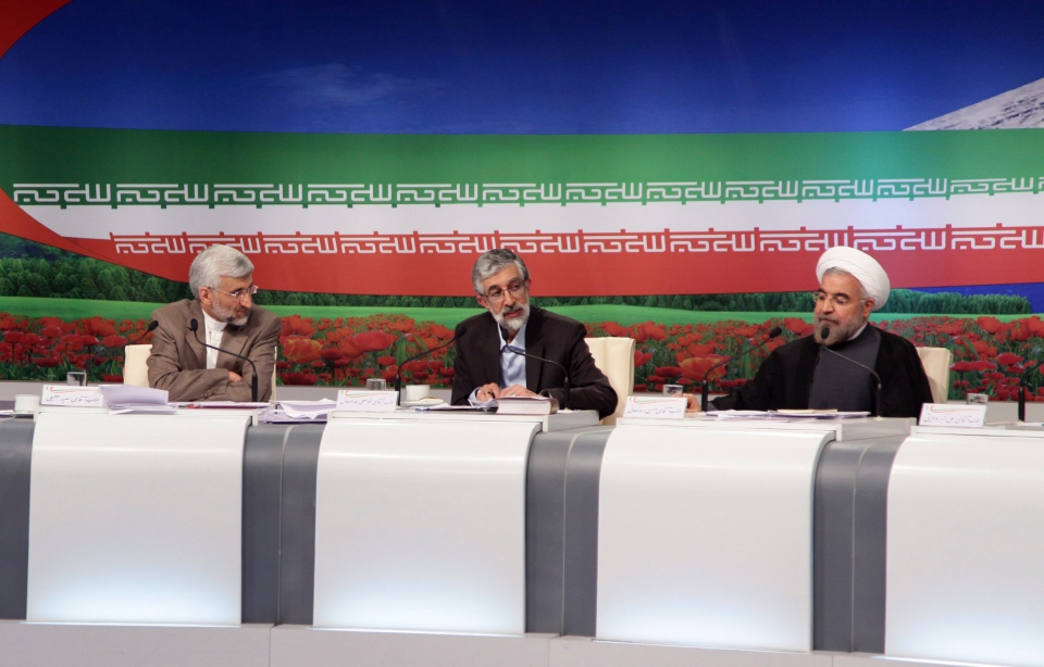 Presidential candidates from left, Saeed Jalili, Iran's top nuclear negotiator, Gholam Ali Haddad Adel, parliament lawmaker, and Hasan Rowhani, former top nuclear negotiator, attend a TV debate, in a state-run TV studio, in Tehran, Iran, Friday, June 7, 2013. (Islamic Republic of Iran Broadcasting / Mehdi Dehghan)