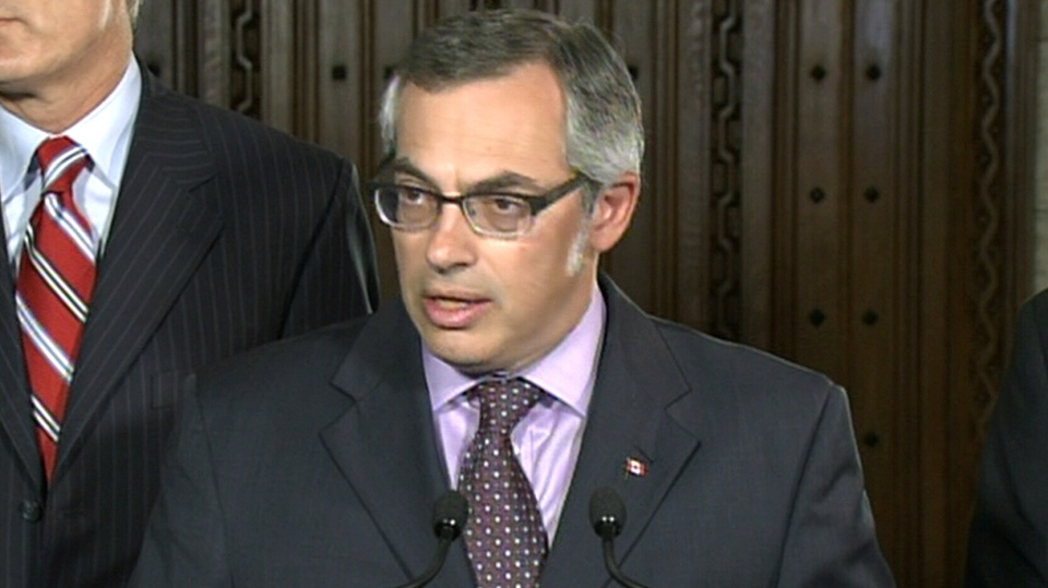 Treasury Board President Tony Clement speaks during a press conference in Ottawa, Monday, June 3, 2013.