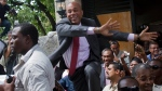 Haiti's presidential candidate Michel 'Sweet Micky' Martelly greets supporters after giving a press conference in Port-au-Prince, Haiti, Tuesday April 5, 2011. (AP / Dieu Nalio Chery)