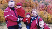 Bryan Casey, 50, appears in this family photo with his wife LeeEllen Carroll and their three children in Gatineau Park in fall 2004.