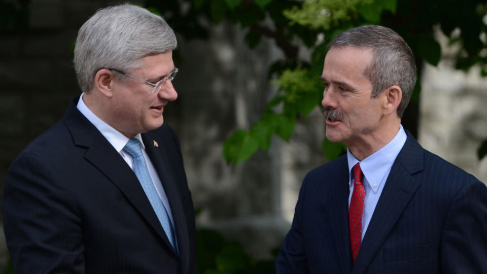 Prime Minister Stephen Harper greets Canadian astronaut Chris Hadfield at 24 Sussex Drive, the official residence of the Prime Minister, in Ottawa on Monday, June 10, 2013. (Sean Kilpatrick / THE CANADIAN PRESS)