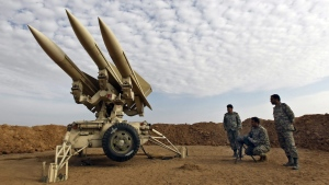 Iranian army members prepare missiles to be launched, during a manoeuvre, in an undisclosed location in Iran on Nov. 13, 2012. (Mehr News Agency / Majid Asgaripour)