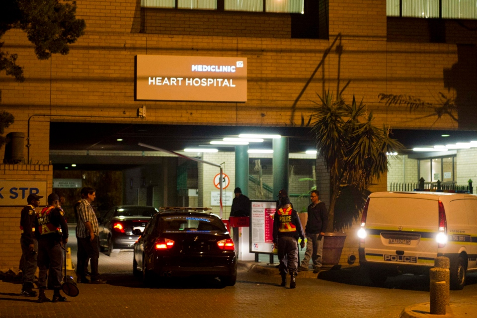 Vehicles entering the hospital in Pretoria, South Africa, Monday, June 10, 2013, where it is believed former president Nelson Mandela is being treated for a recurring lung infection, undergo searches at the entrance. (AP Photo)