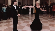 Actor John Travolta is shown dancing with Princess Diana at a White House dinner on Nov. 9, 1985. Several of the most famous gowns worn by Princess Diana are set to hit the auction block this summer in Toronto. Highlights include the dress Diana wore at the White House state dinner hosted by then-president Reagan and his wife, Nancy, when the princess famously danced with actor John Travolta. I(Ronald Reagan Library)
