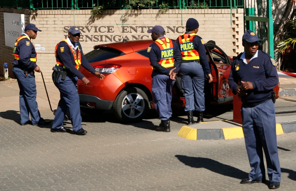 Police officers check a vehicle entering the hospital in Pretoria, South Africa, Tuesday, June 11, 2013, where it is believed former president Nelson Mandela is being treated for a recurring lung infection. (AP / Themba Hadebe)