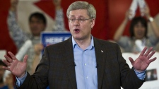 Prime Minister Stephen Harper delivers a speech at a campaign event in Guelph Ont., on Monday, April 4, 2011. (THE CANADIAN PRESS/Sean Kilpatrick)
