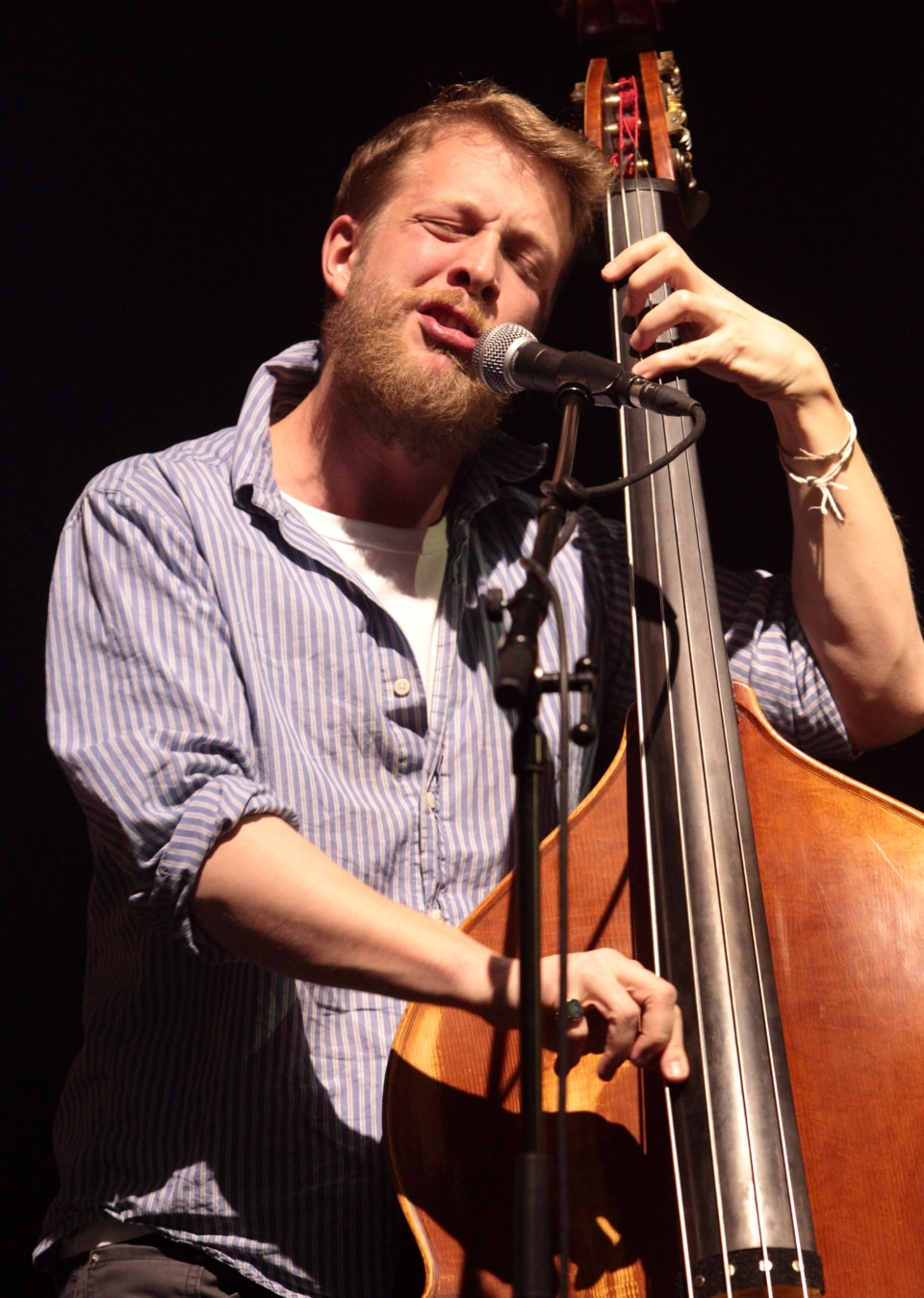 Ted Dwane, of the English folk rock band Mumford & Sons, performs at the Susquehanna Bank Center in Camden, N.J., in this February 2013 file photo. Dwane has a blood clot on his brain that will require surgery. (AP Photo/Invision/Owen Sweeney)