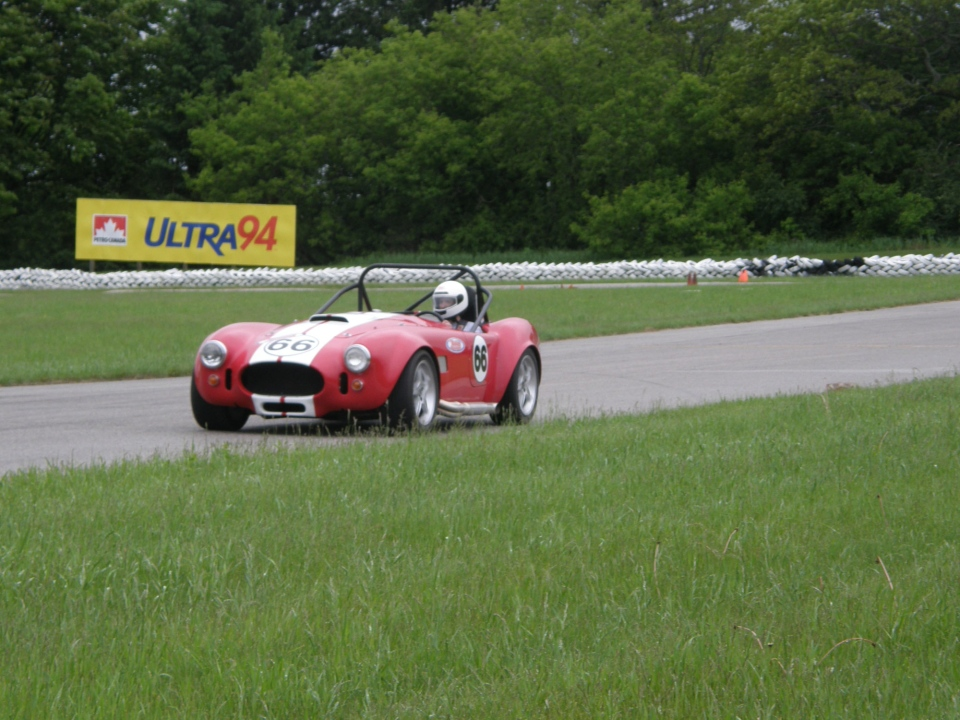 CTVNews.ca's Brent Jamieson comes out of the final corner of the racetrack in the Replica Cobra (Allan Jamieson)