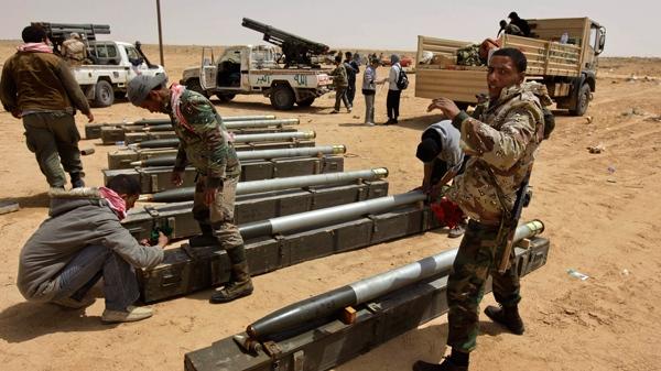 Libyan rebel fighters prepare rockets for use at a position west of Ajdabiya, Libya, Wednesday, April 6, 2011. (AP / Ben Curtis)