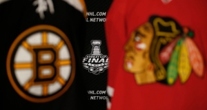 The 2013 NHL Stanley Cup logo is seen between the sweaters of the Boston Bruins and Chicago Blackhawks during a news conference for the Stanley Cup Final hockey series between the Blackhawks and the Bruins Tuesday, June 11, 2013 in Chicago. (AP / Charles Rex Arbogast)