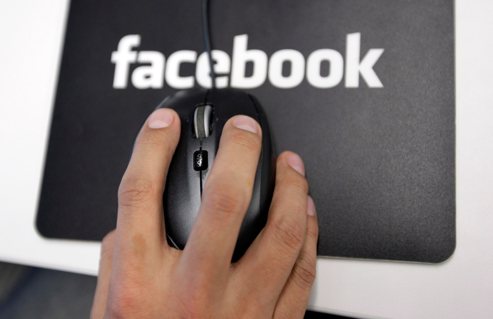 A Facebook employee is shown at the company's headquarters in Menlo Park, Calif., in 2011. (AP / Paul Sakuma)