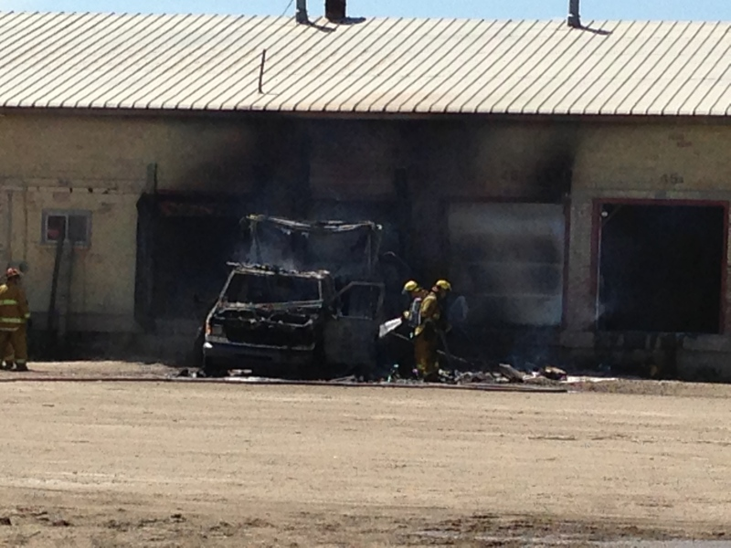 A vehicle fire spread to a Regina business Wednesday afternoon.