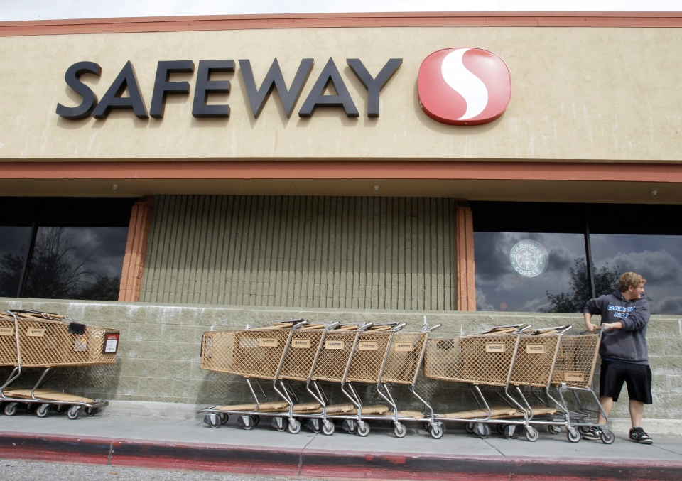 A customer grabs a shopping cart at a Safeway store in Cupertino, Calif., Feb. 23, 2011. (AP / Paul Sakuma)