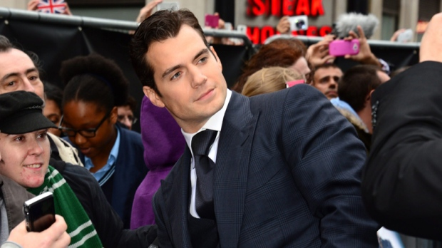 Actor Henry Cavill signs autographs for fans at the European Premiere of 'Man Of Steel' in London on Wednesday, June 12, 2013. (Photo by Jon Furniss / Invision / AP)