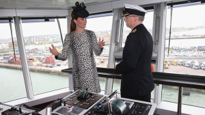 Duchess of Cambridge receives an on board tour with Captain Tony Draper during the Princess Cruises ship naming ceremony to officially name the new Royal Princess cruise liner at a gala ceremony, in Southampton, England, Thursday June 13, 2013. (AP Photo/Chris Jackson, Pool)