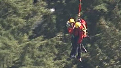 Search and rescue teams performed a dramatic long line helicopter rescue in North Vancouver, B.C., to save a missing puppy on April 7, 2011. (CTV)