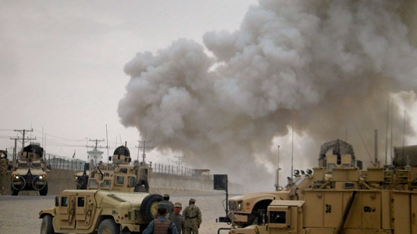 Smoke billows from a police compound after it was attacked by insurgents in Kandahar, south of Kabul, Afghanistan on Thursday, April 7, 2011. (AP / Khalid Sial)