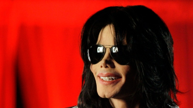 Michael Jackson speaks at a news conference in London on March 5, 2009. (AP / Joel Ryan)