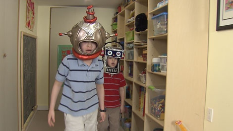 Brothers Luke and Andrew Chaplin dress up as robots in their Burnaby home. April 7, 2011. (CTV)