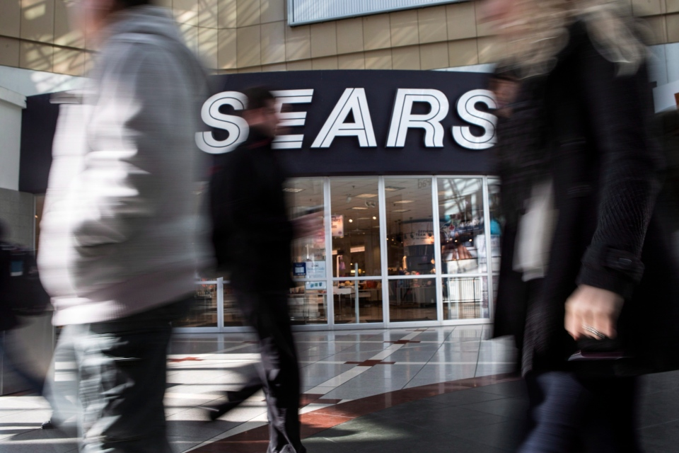 Commuters walk past a Sears store in Toronto on Thursday, April 25, 2013. (The Canadian Press/Chris Young)