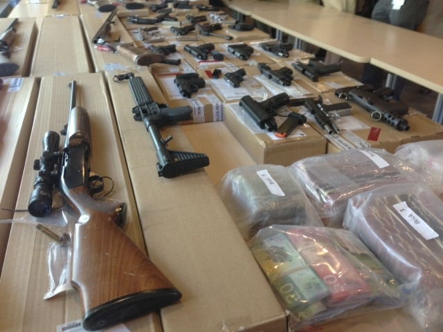 Toronto police show off firearms and cash at a news conference on Friday, June 14, 2013, after the items were seized during Project Traveller raids. (CP24/Cam Woolley)